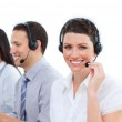 Enthusiastic customer service agents working in a call center — Stock Photo #10284130