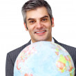Charisatic businessman holding a terrestrial globe - Stock Photo