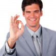 Cheerful businessman showing OK sign — Stock Photo #10284394