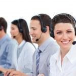 Multi-ethnic business team talking on headset — Stock Photo