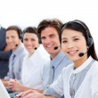 sorridente team business parlando sull'auricolare — Foto Stock