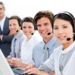 A diverse business team talking on headset — 图库照片