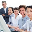 International business team talking on headset — Stok fotoğraf
