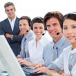 International business team talking on headset — Stockfoto