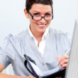 Positive business woman writting on her agenda — Stock Photo