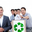 Confident business showing the concept of recycling — Stock Photo
