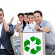 Cheerful business showing the concept of recycling - Stock Photo