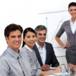 Smiling international business at a presentation — Stock Photo #10284988