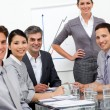 A diverse business team at a presentation — Stock Photo