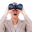 Surprised businesswoman looking through binoculars — Stock Photo #10285053