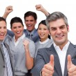 Happy manager with thumbs up standing with his team — Stock Photo #10285086