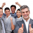 Happy manager with thumbs up standing with his team — Stock Photo