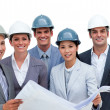 International architects studying blueprints — Stock Photo #10285114