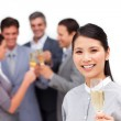 Cheerful manager and her team celebrating a success — Stock Photo