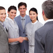 Young business partners shaking hands — Stock Photo