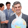 Ambitious manager and his team holding a terrestrial globe - Foto Stock