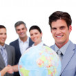 Successful manager and his team holding a terrestrial globe — Stock Photo #10285174