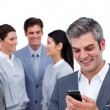 Stock Photo: Enthusiastic businessman and his cellphone standing apart from h