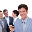 Charming manager on phone standig in front of his team — Stock Photo #10285221