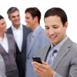 Assertive manager on phone standig in front of his team — Stock Photo