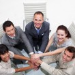 Smiling business team with hands together — 图库照片