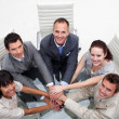 Smiling business team with hands together — Stock Photo