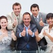 Confident business team with thumbs up — Stock Photo