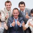 Happy business team with thumbs up — Stock Photo