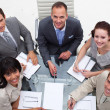 Stock Photo: Business team working together in an office