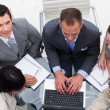 High angle of businessman working with his team — Stock Photo