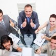 Exuberant business team with thumbs up — 图库照片