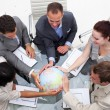 Stock Photo: High angle of business holding the world