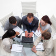 High angle of business team working together in an office — ストック写真