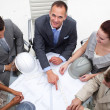 Architect manager pointing at a blueprint in a meeting — Stock Photo #10285288