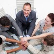 Close-up of multi-ethnic business team with hands together — Stock Photo
