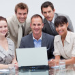 Multi-ethnic business team working together in an office — Stock Photo