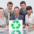 Smiling business team holding a recycling symbol. Ecological bus — Stock Photo