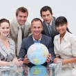 Stock Photo: Business team holding terrestrial globe. Global business