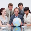 Business team holding the world. Global expansion — 图库照片