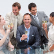 Foto Stock: Business team toasting with champagne in the office