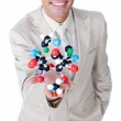 Close-up of a businessman holding a molecule — Stock Photo #10285461