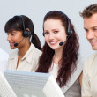 Attractivel woman working in a call center — Stock Photo