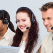Beautiful woman working with her team in a call center — Stock Photo #10285516