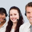 Smiling team working in a call center — Stock Photo