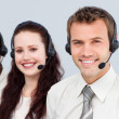 Young team with a headset on working in a call center — Stok fotoğraf