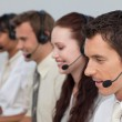 Attractive man with a headset on working in a call center — Stock Photo #10285527