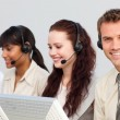 Smiling attractive businessman working in a call center — Stock Photo #10285592