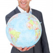 Cheerful businessman holding a terreatrial globe — Stock Photo