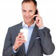 Attractive businessman talking on phone — Stock Photo