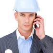 Serious male architect on phone — Stock Photo